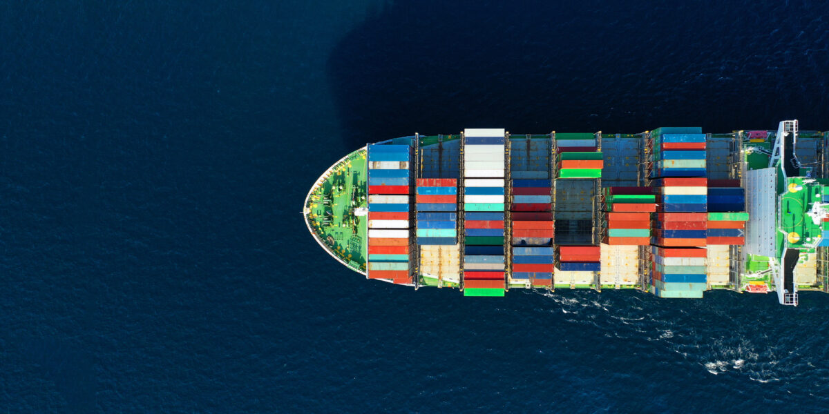 Panoramic photo of industrial container tanker ship cruising in open ocean
